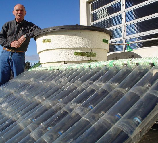 Man standing by Solar Heater