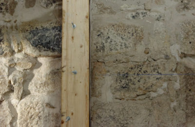 Stone wall with timber reinforcement