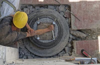 Man in hard hat tightening bolt
